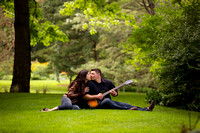 Engagement portrait with guitar at Dow Gardens in Midland, Michigan