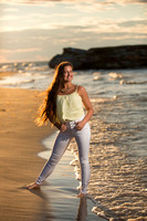 senior portrait on beach by water