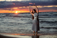 senior dancer in water at sunset