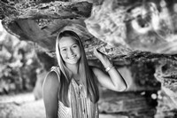 senior portrait with rock formation in black and white